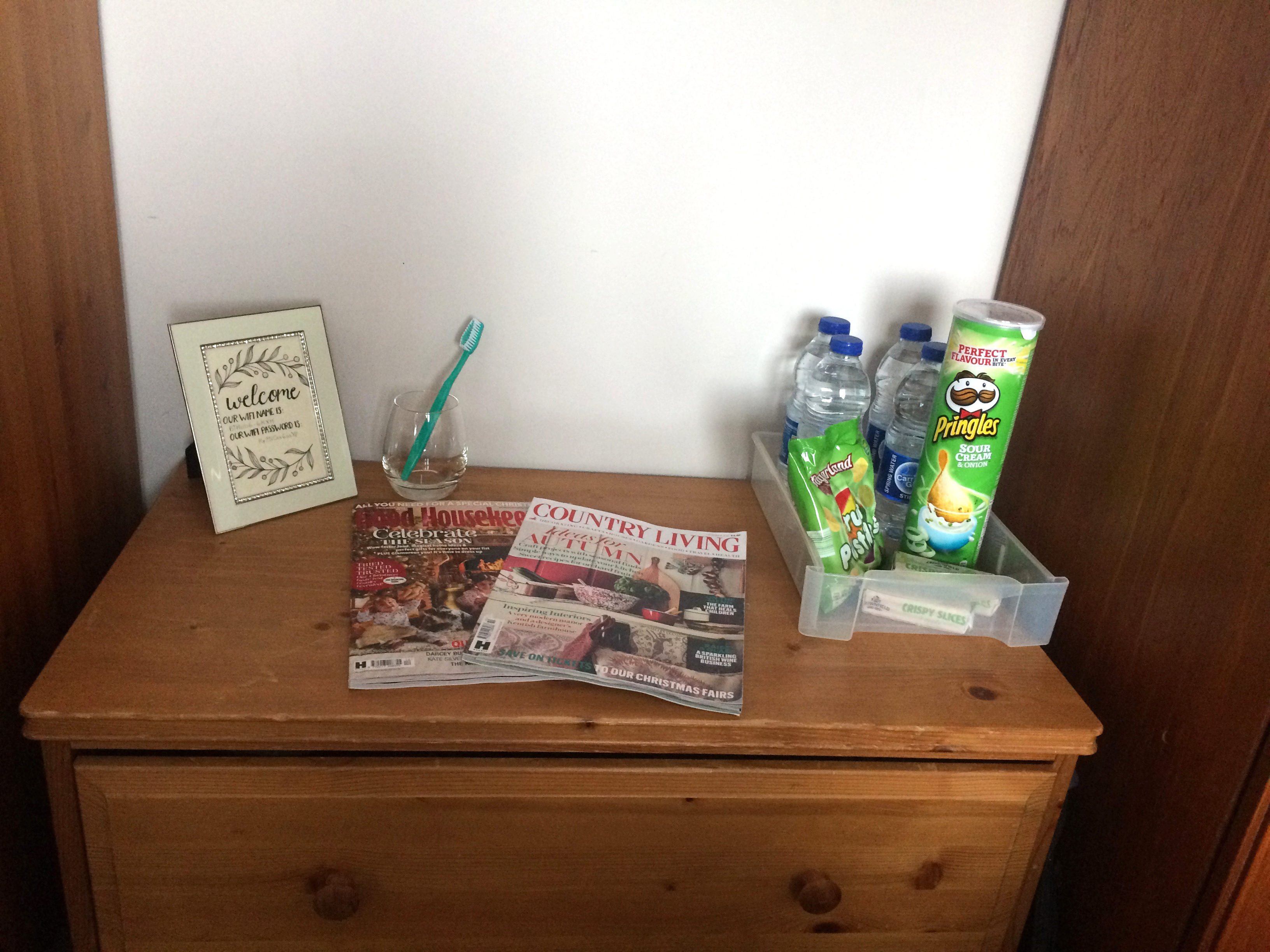 How to create an inviting guest room by a Hopeful Home. Nightstand decoration. Top dresser with all the guest necessities.