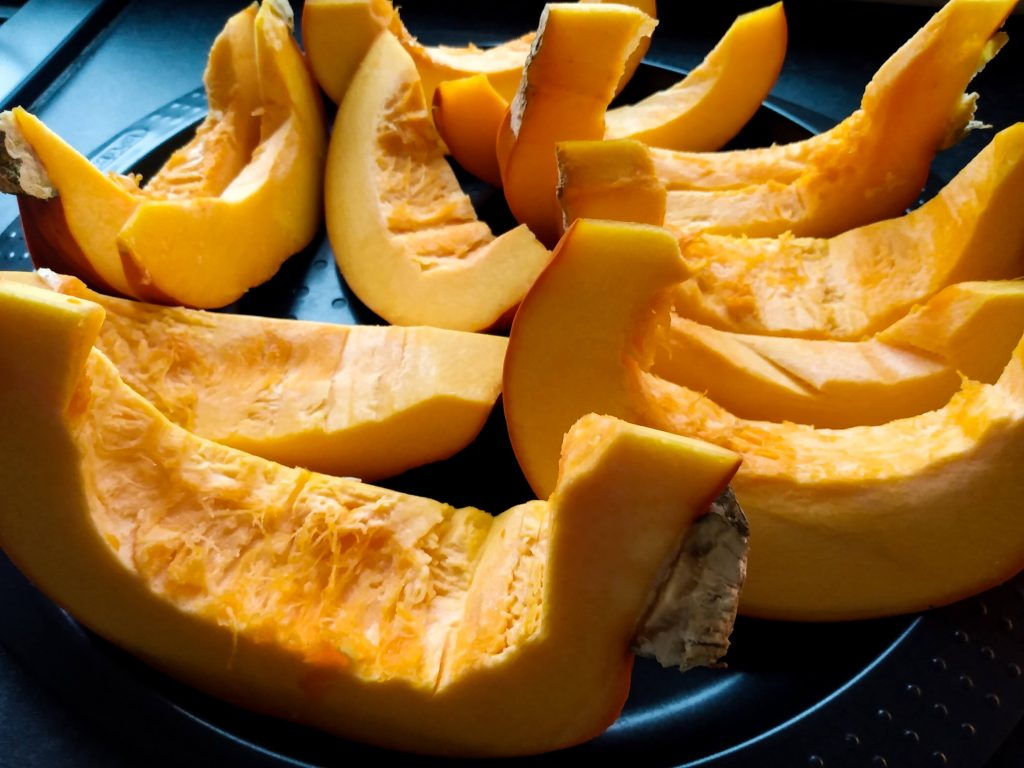 Slices pumpkin. How to Make Pumpkin Puree From Scratch by a Hopeful Home.