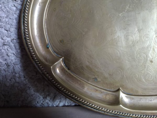 Close up round brass tray by a Hopeful Home webshop for rustic vintage homeware.