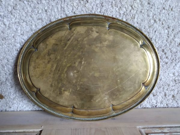 The back of round brass tray by a Hopeful Home webshop for rustic vintage homeware.
