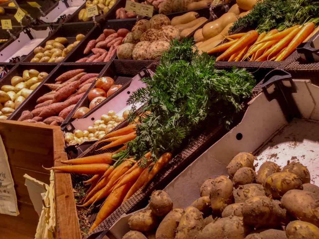 Image of vegetables in Farmshop. 5 reasons why you should eat the seasons in the UK by a Hopeful Home.