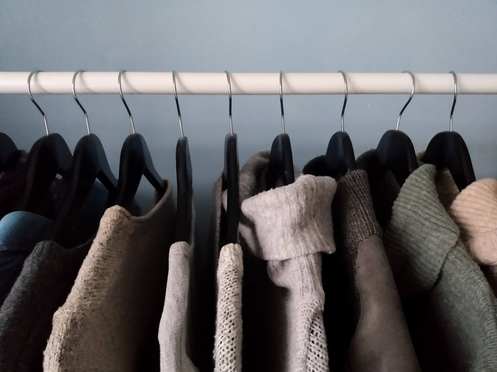 Clothing rack with clothes on it. 5 Benefits of Buying Second Hand Clothes by a Hopeful Home.