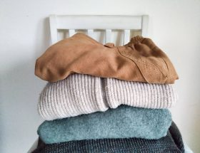 Pile of clothes. 5 Benefits of Buying Second Hand Clothes by a Hopeful Home.