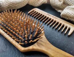 Close up tek hair brush and comb. Wooden hair brush review by a hopeful home.