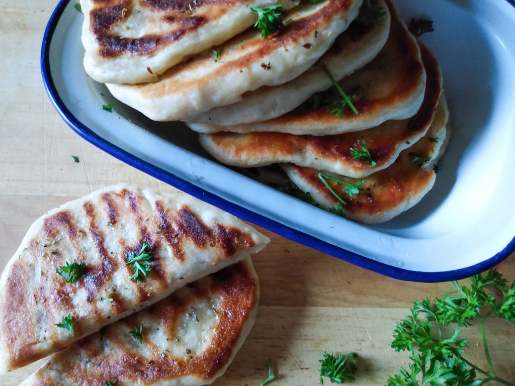 Close up naan bread. Easy homemade naan bread recipe by A Hopeful Home.