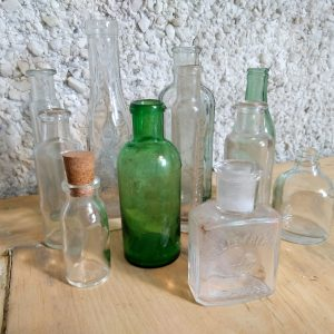 Antique glass pharmacy bottles.