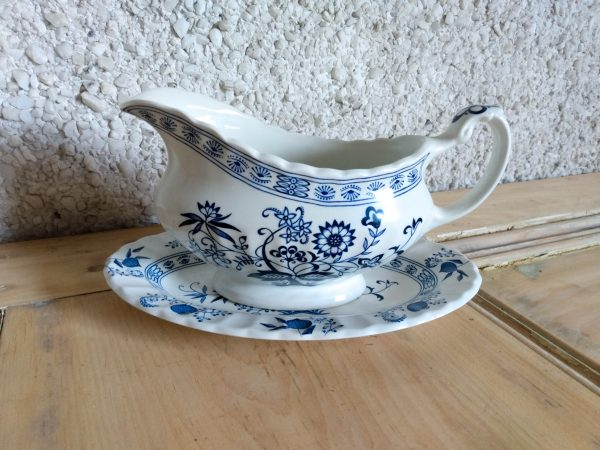 Blue white ironstone gravy boat and stand.